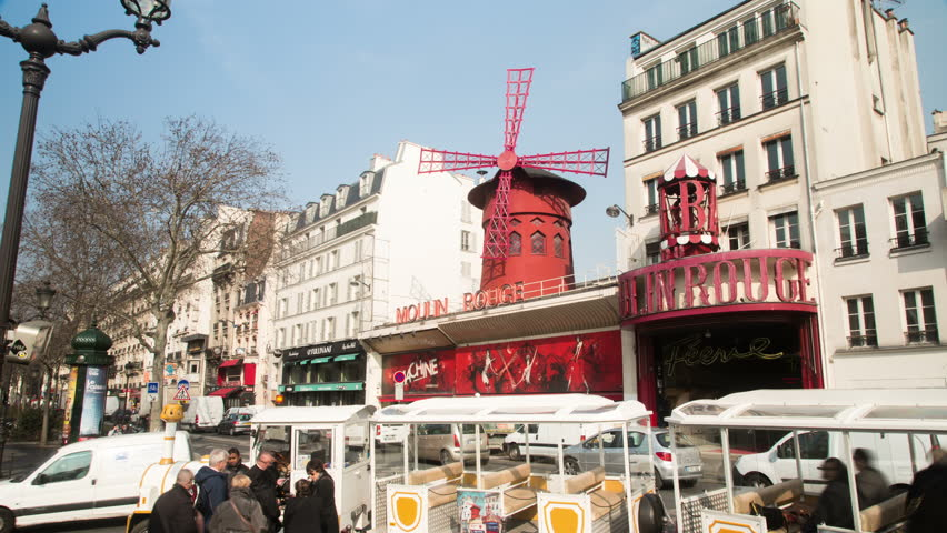 PARIS - MARCH 14: Timelapse of the Moulin Rouge in Montmartre in the daytime March 14, 2015 in Paris, France