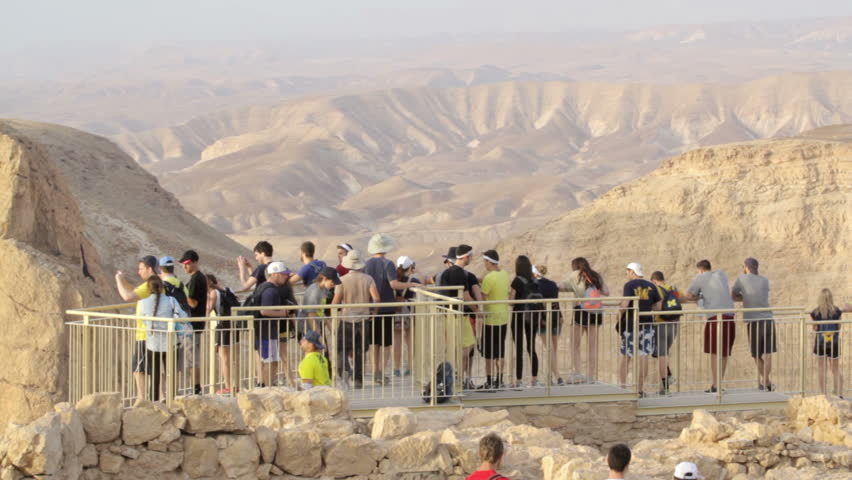 MASADA, ISRAEL - May 15, 2015: Group of young tourists enjoying on 
