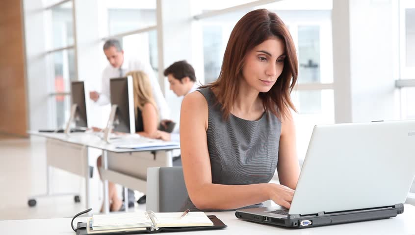 Businesswoman in office with laptop computer - HD stock footage clip