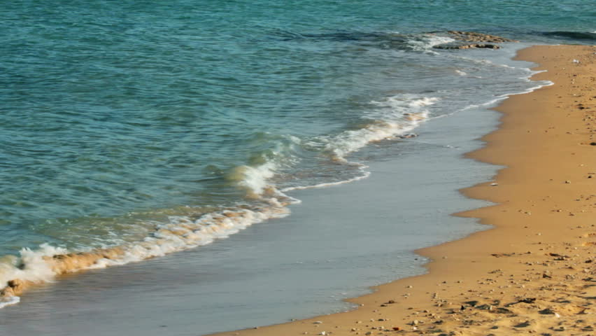 turquoise sea water waves and sand beach - HD stock video clip