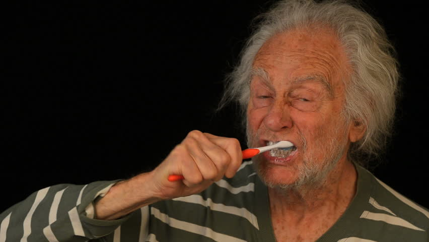 Old Man brushes teeth - HD stock footage clip
