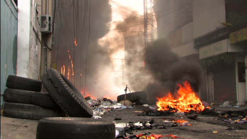 Burning street after riot conflict protest with police. - HD stock video clip