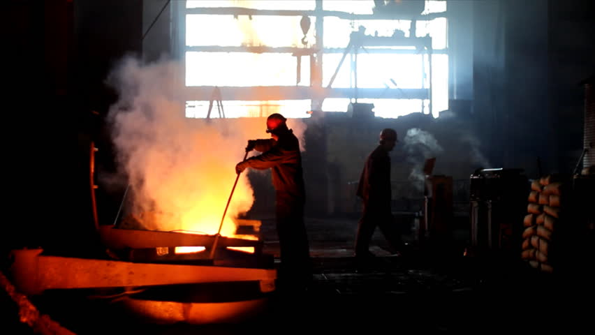 Putting iron in the furnace to melt - HD stock video clip