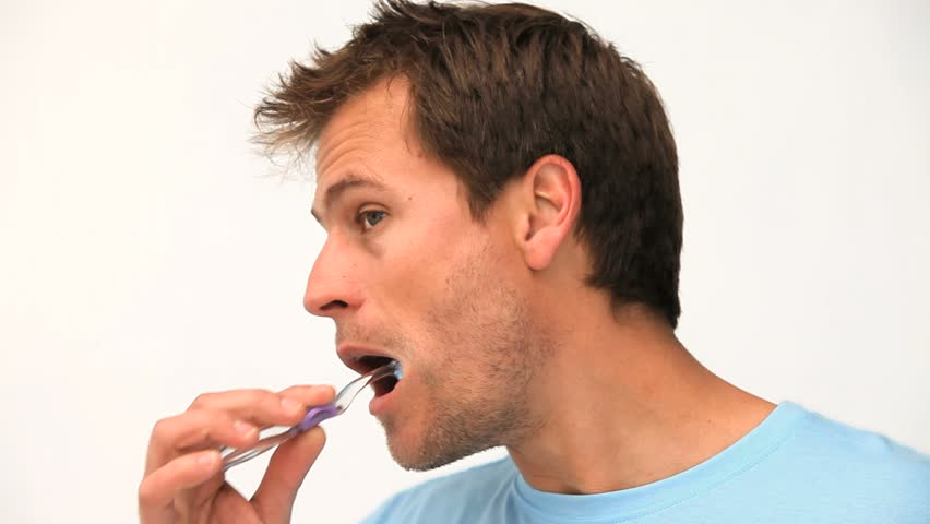 Handsome man brushing his teeth - HD stock video clip