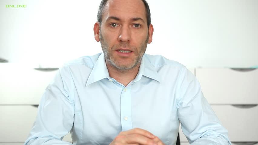Businessman having a conversation via webcam - HD stock footage clip