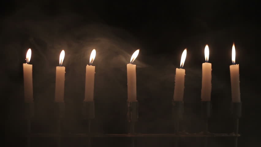 Candles with smoke on black background