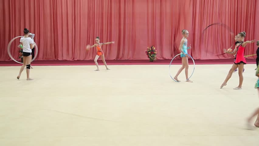 CHELYABINSK, RUSSIA - DECEMBER 02,2012:V Chelyabinsk Region Governor's Cup rhythmic gymnastics.Rhythmic gymnastic Training athletes in the hall before the event Young girls do calisthenics art sport