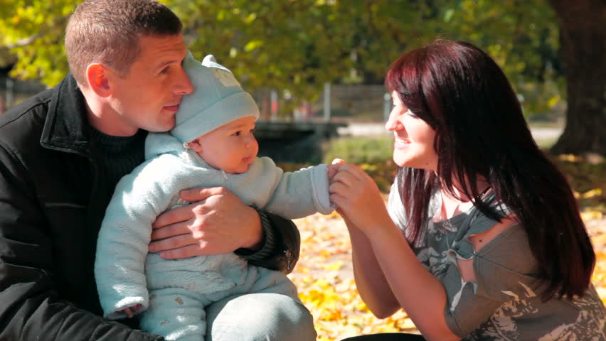 Happy Family Holding Their Child - HD stock footage clip