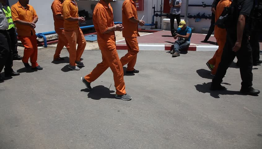 ATLIT, ISRAEL - JUNE 03, 2015: Policemen evacuate prisoners from Carmel Prison after simulated rocket attack in Turning Point 15 national drill.