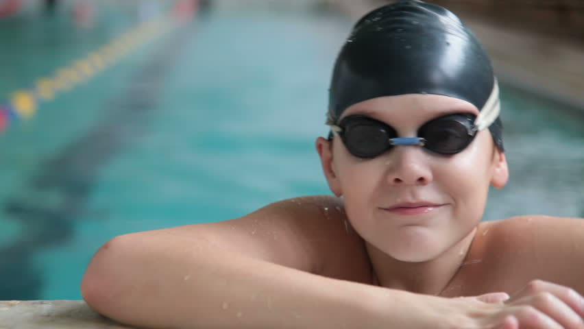 child competing in a swimming race
