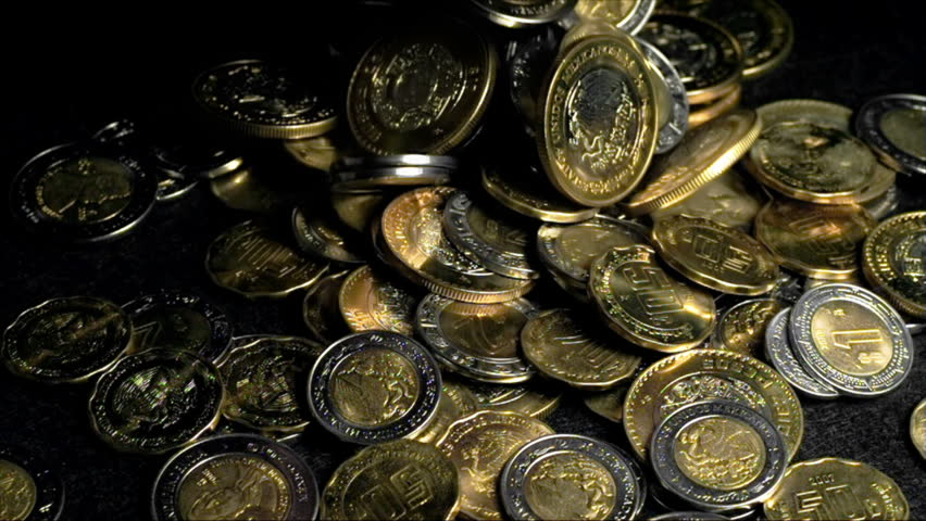 Mexican Peso Coins Falling In a Pile Super Slow Motion