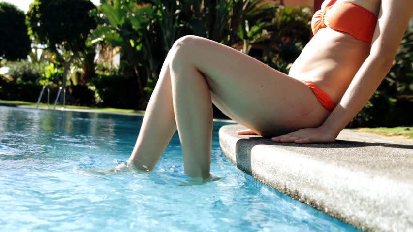 Young woman's legs in the swimming pool  - HD stock video clip