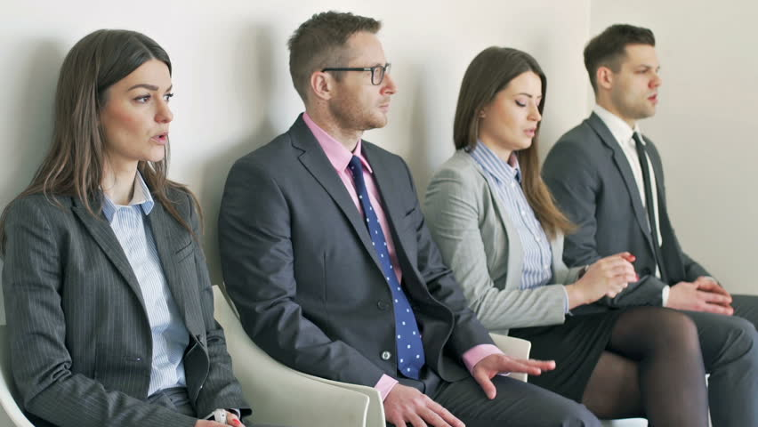 Nervous businesspeople waiting for interview