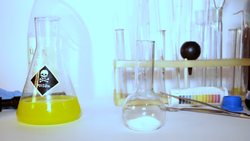 Mad professor conducts strange experiments with different chemical material. - HD stock video clip