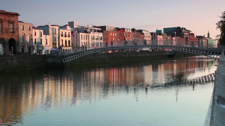 People crossing the Ha'penny Bridge, Dublin, Ireland. - HD stock footage clip