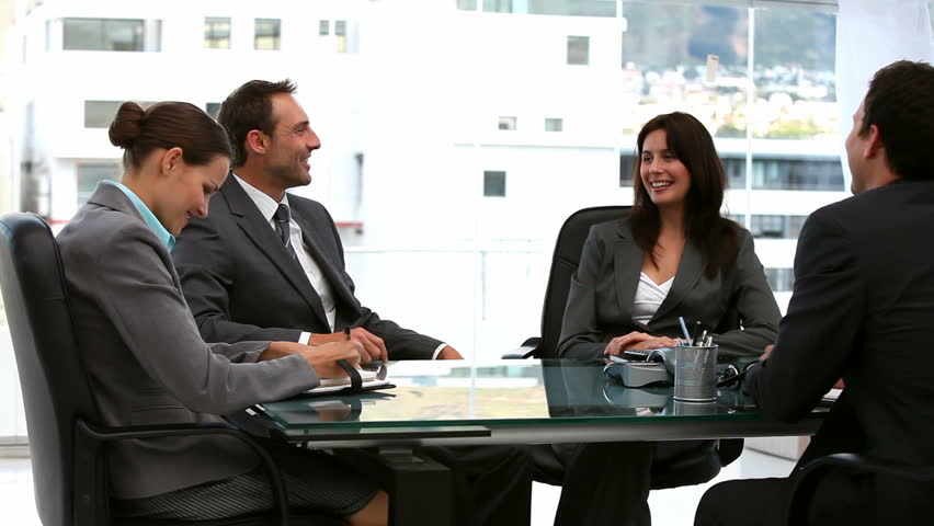 Businessmen and businesswomen working together - HD stock video clip