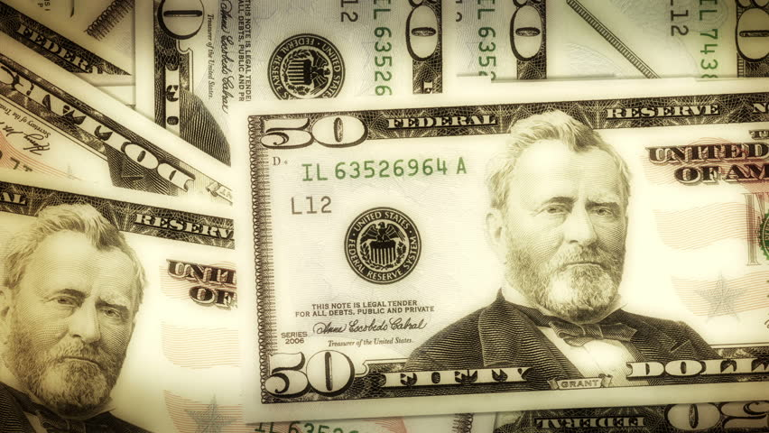 A pile of dollar notes turns into letters that forms the word Wall Street - HD stock video clip
