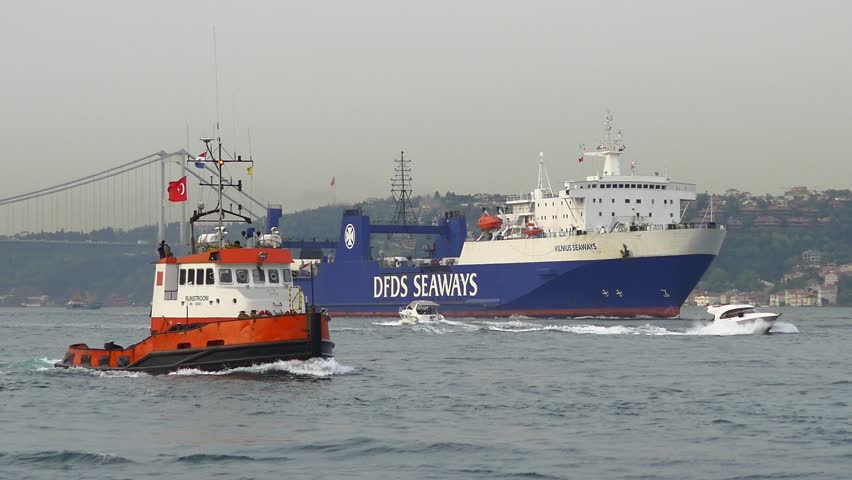 ISTANBUL - MAY 16, 2015: Shiphandling tug boat RIJNSTROOM (Flag: Netherlands) sails into Bosporus Sea. Vessels of Van Wijngaarden Marine Services work for mainly on projects in transport industries