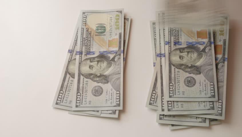 100 dollar bills on table