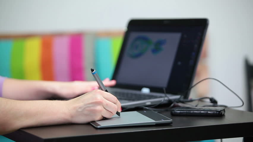 Unrecognizable woman working with pen and tablet, graphic designer