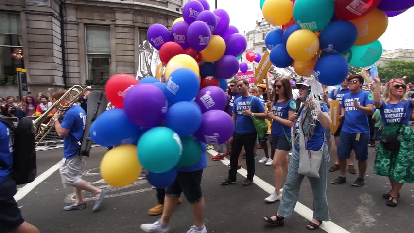 LONDON - JUNE 27: People take part in London's Gay Pride, 2015 Worldpride on June 27, 2015 in London, UK, estimated 25,000 people took part in the march, Parade to support gay rights.  - HD stock video clip