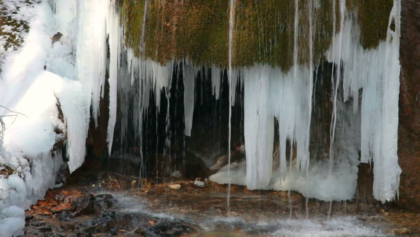 Waterfall Silver stream and mossy rock in winter. Grand Canyon, Crimea, Ukraine - HD stock footage clip