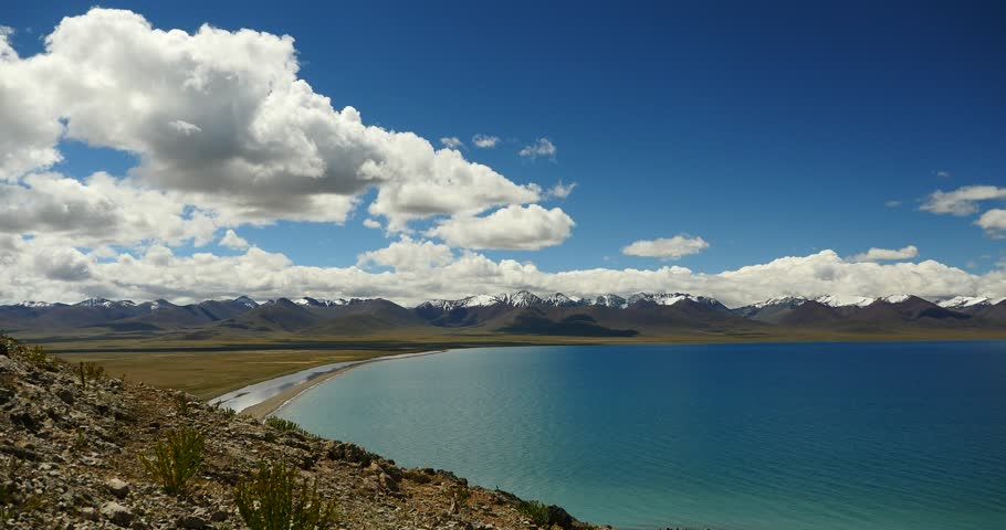 4k huge clouds mass rolling over lake namtso & Tanggula snow mountain peak,tibet mansarovar,Tibet's second largest lake,is the third largest saltwater lake in China.roof of the World.
