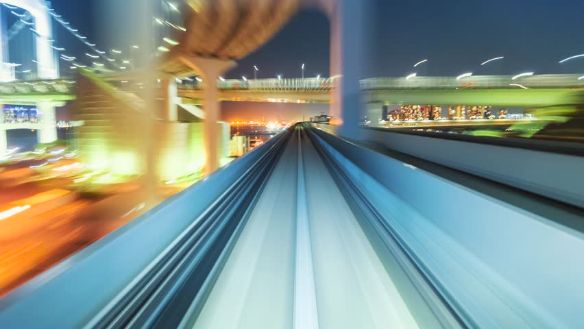 Point of view time-lapse through Tokyo via the automated guideway transit system (AGT) called the Yurikamome. Full ride at night. Shot in 5.7K and down-scaled to 4K for extra sharp resolution. - 4K stock footage clip