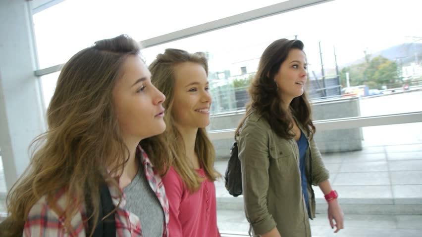 Teenage girls walking in high-school hall | Shutterstock HD Video #1065328