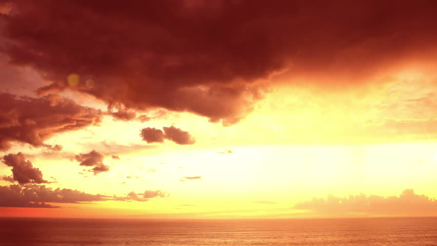 Beautiful sunset clouds over ocean. Time Lapse. - HD stock footage clip