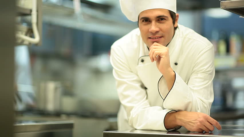 Portrait of a young chef; HD: Photo JPEG - HD stock video clip