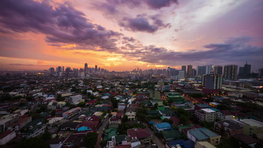 Timelapse of twilight over Metro Manila transitioning to night, Philippines