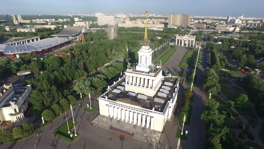 MOSCOW, RUSSIA - JULY 2015: Central Pavilion of VDHkH.  All-Russian Exhibition Center. HELICOPTER VIEW of Central Pavilion with surrounding park. Part 1 (motion continues in part 2) - 4K stock video clip