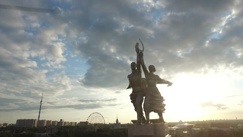 RUSSIA. MOSCOW. VDNkH. JULY 2015: Rabochiy i Kolkhoznitsa (Worker and Kolkhoz Woman) by sculptor Vera Mukhina. Sunset time. HELICOPTER VIEW 10 - 4K stock footage clip