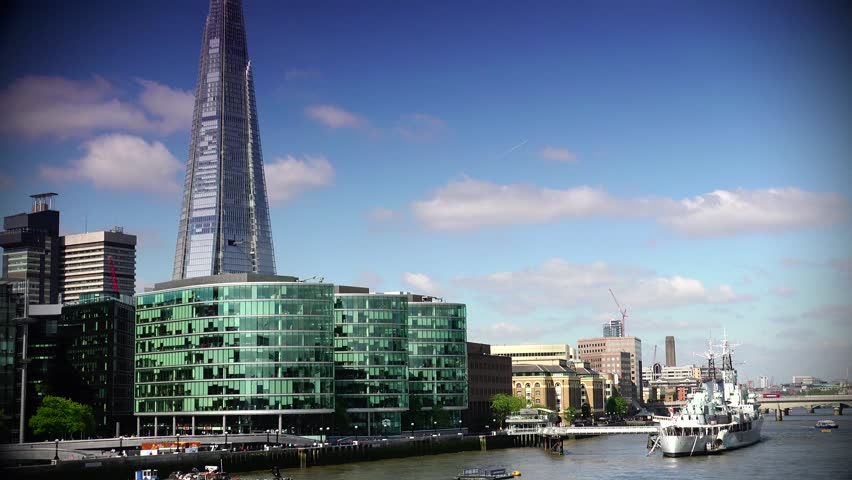 LONDON - MAY 10 3015: London skyline on Thames river with Shard in the background. Completed in 2012, it is the tallest building in the European Union. ULTRA HD 4k,real time,zoom - 4K stock footage clip
