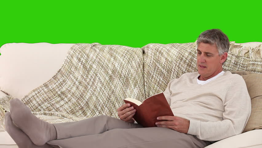 Chromakey footage of a casual retired man reading a book - HD stock footage clip