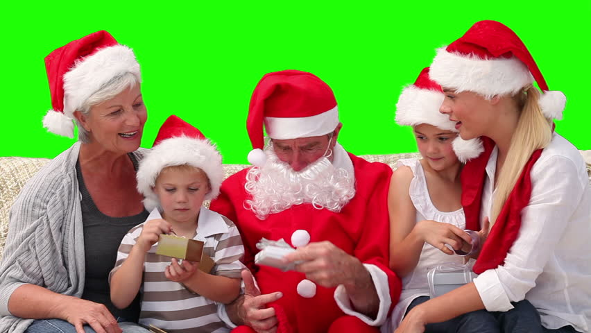 Christmas with Santa Claus in a family against a green screen - HD stock footage clip