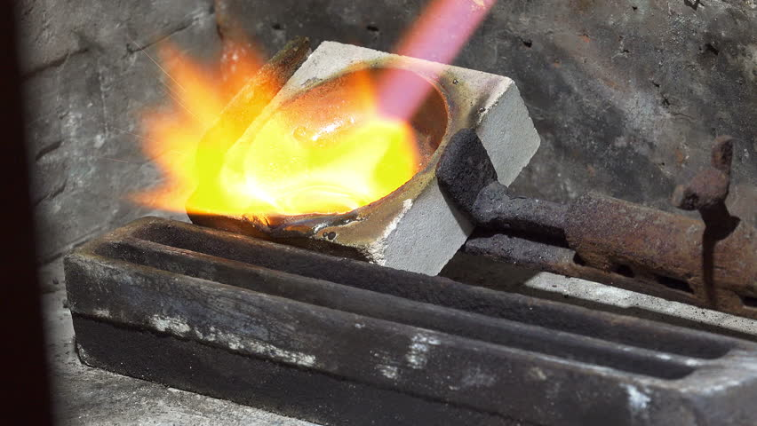 Melting Silver With Gas Burner In Jewelry Workshop Stock