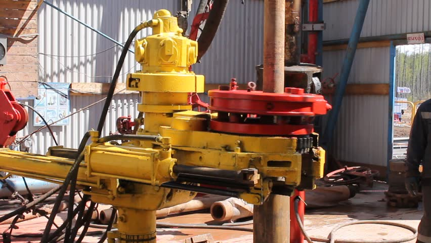 Drill Pipe And Rig Tong On The Rig Floor While Making Up