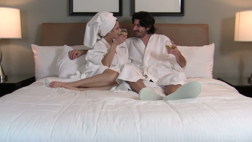 Romantic couple drinks wine in bed - HD - HD stock video clip