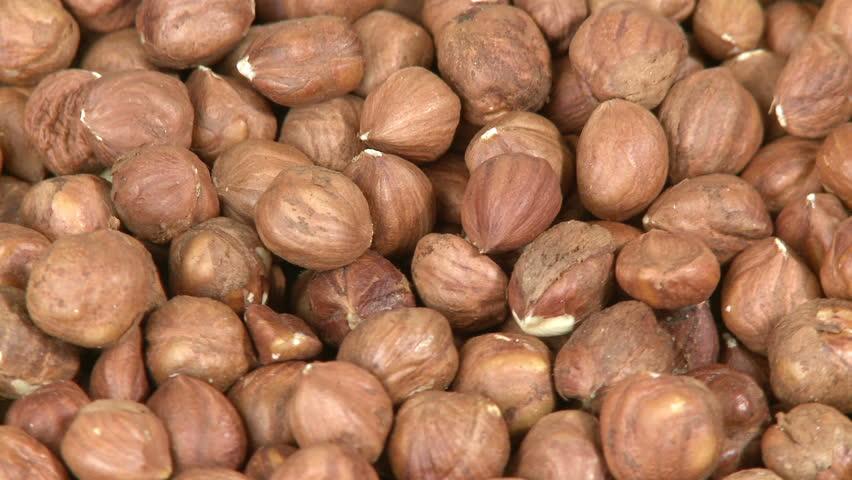 Hazelnuts background close-up  - HD stock video clip