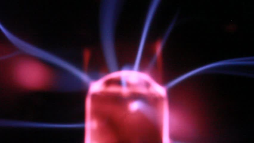 closeup of source of light wave move in plasma ball - HD stock video clip