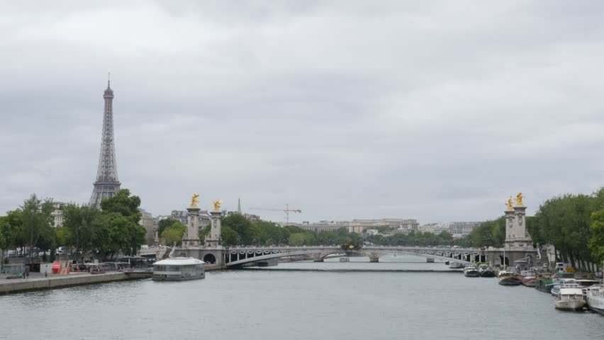 Beautiful Paris scenery with river Seine Eiffel tower and Alexandre III bridge 4K 2160p UltraHD tilt footage - Famous Paris sights by the day slow tilting 4K 3840X2160 UHD video - 4K stock footage clip