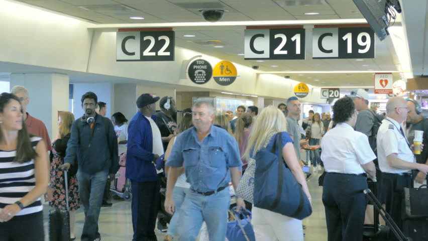 PHILADELPHIA, PA - JULY 28, 2015:  Crowd of people at busy Philadelphia International Airport on July 28, 2015. Philadelphia Airport is a major airport and international hub in Pennsylvania, United States.