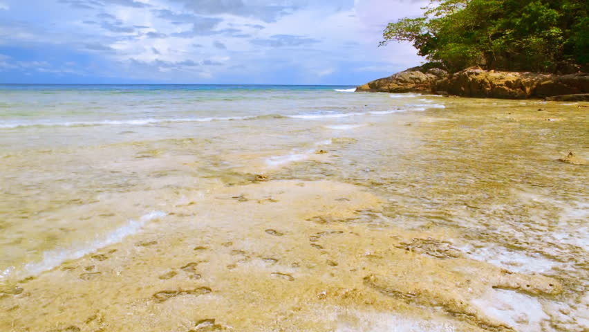 Lightweight waves rolling by a coral reef. FullHD 1080p. - HD stock footage clip