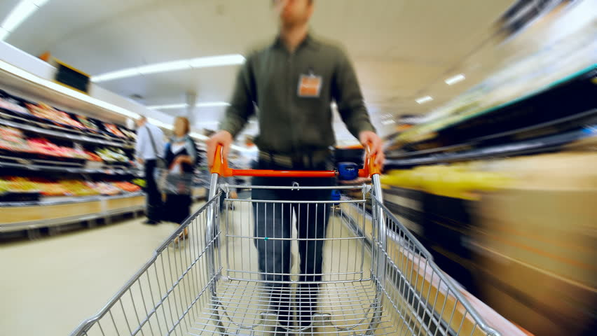Time Lapse of man pushing empty trolley around supermarket. Footage loops, Camera fixed to Shopping Cart
