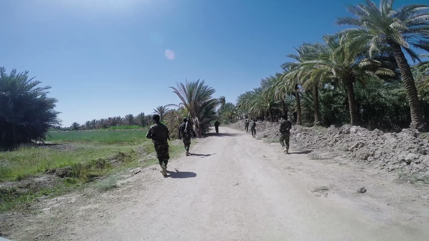 JURF AL NASR, IRAQ: MAY 2015: A patrol for Iraqi army and Hezbollah battalions. In 2014, Jurf Al-Nasr witnessed fierce battles between ISIS and Iraqi army supported by popular mobilization forces