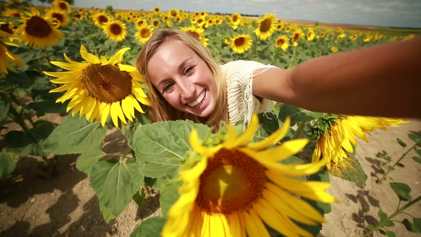 Cheerful young woman arms outstretched in the middle of a for Cheerful nature