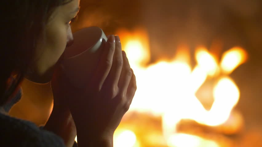 4 in 1 video! The young girl and men drink tea (coffee) and rest by bonfire background. Portrait view. Shot with Red Cinema Camera - 4K stock video clip