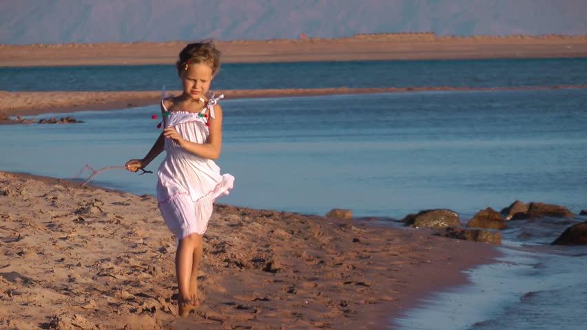 little girl running on the beach - HD stock video clip
